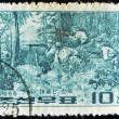 CHINA - CIRCA 1966: A stamp printed in china shows soldiers firing among the trees, circa 1966 — Stock Photo