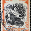 Stock Photo: COSTA RICA - CIRCA 1950: A stamp printed in Costa Rica dedicated to agricultural fair, livestock and industrial Carthage, shows a woman picking coffee, circa 1950