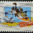 Постер, плакат: FRANCE CIRCA 2009: A stamp printed in France shows Wile E Coyote and the Road Runner Looney Tunes circa 2009