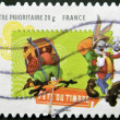 Постер, плакат: FRANCE CIRCA 2009: A stamp printed in France shows Bugs Bunny and Daffy Duck as scouts circa 2009