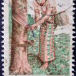 INDIA - CIRCA 1980: A stamp printed in India dedicated to crafts, shows a Women collecting rubber from a tree, circa 1980 — Stock Photo