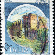 Stock Photo: ITALY - CIRC1980: stamp printed in Italy, shows Castles Bosa, Italiseries of castles , circ1980