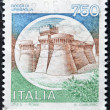 ITALY - CIRCA 1990: A stamp printed in Italy shows image of the Rock of Urbisaglia, Italian series of castles, circa 1990 — Stock Photo #9181607
