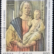 ITALY - CIRCA 2001: A stamp printed in Italy shows the Virgin and Child by Piero della Francesca, circa 2001 - ストック写真