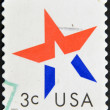 A stamp printed in USA shows star — Stock Photo