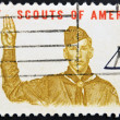 Постер, плакат: UNITED STATES CIRCA 1960: A stamp printed in USA shows Boy scout Giving scout sign circa 1960