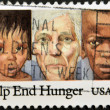 "Foto de Stock  : Asiand africchildren with older caucasian, inscription ""Help end Hunger"""