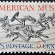 UNITED STATES OF AMERICA - CIRCA 1964: A stamp printed in USA, shows Lute, Horn, Laurel, Oak and Music Score, circa 1964 — Stock Photo