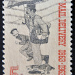 UNITED STATES OF AMERICA - CIRCA 1963: A stamp printed in the United States of America shows Letter Carrier, centenary of free city mail delivery, circa 1963 — Stock Photo #9182626