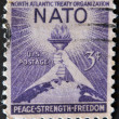 USA - CIRCA 1952 : A stamp printed in the USA shows North Atlantic Treaty Organization (NATO), Peace, Strenght, Freedom, circa 1952 — Stock Photo