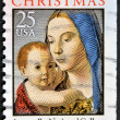 Stamp printed in USA shows image of art by Antonello - Virgin and child - ストック写真