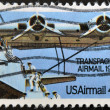 Plane with inscription Transpacific airmail — Stock Photo
