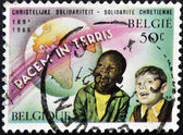 A stamp printed in Belgium dedicated to peace on earth — Stock Photo