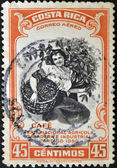 COSTA RICA - CIRCA 1950: A stamp printed in Costa Rica dedicated to agricultural fair, livestock and industrial Carthage, shows a woman picking coffee, circa 1950 — 图库照片