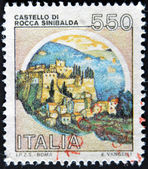 ITALY - CIRCA 1980: A stamp printed in Italy, shows castle or rock Sinibald — Stock Photo