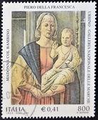 Italien - ca 2001: en stämpel tryckt i italien visar virgin och barn av piero della francesca, ca 2001 — Stockfoto