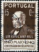 Portugal - circa 1940: um selo imprimido em portugal mostra sir rowland hill, por volta de 1940 — Fotografia Stock