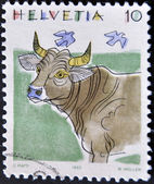 A stamp printed in Switzerland, shows a cow — Stock Photo
