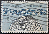 UNITED STATES OF AMERICA - CIRCA 1963: a stamp printed in the United States of America shows Globe and Stars, The Universe — Stock Photo