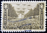 USA - CIRCA 1945 : stamp printed in USA show USA Army on the Champs Elysees, under the Arc de Triomphe in Paris , circa 1945 — Stock Photo