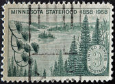 UNITED STATES OF AMERICA - CIRCA 1958: A stamp printed in USA shows Minnesota Lakes and Pines, circa 1958 — Stock Photo