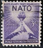 USA - CIRCA 1952 : A stamp printed in the USA shows North Atlantic Treaty Organization (NATO), Peace, Strenght, Freedom, circa 1952 — Stock Photo