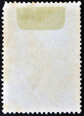 The reverse side of a postage stamp. — Stockfoto