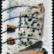 Royalty-Free Stock Photo: Stamp shows a portion of blue cheese
