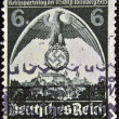 GERMAN REICH - CIRC1935: stamp printed in Germany shows nazi eagle badge, circ1935 — Stock Photo #9443666
