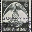 Stock Photo: GERMAN REICH - CIRCA 1935: A stamp printed in Germany shows nazi eagle badge, circa 1935