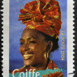 FRANCE - CIRCA 2004: A stamp printed in France shows madras headdress, circa 2004 - Stock Photo