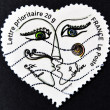 Foto de Stock  : FRANCE - CIRC2003: stamp printed in France shows two kissing in heart by Franck Sorbier, circ2003