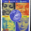 Stock Photo: FRANCE - CIRC1998: stamp printed in France shows faces of of different races in reference to universal declaration of humrights, circ1998