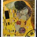 Постер, плакат: FRANCE CIRCA 2002: A stamp printed in France shows The Kiss by Gustav Klimt circa 2002