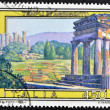 A stamp printed in Italy shows temples of Agrigento - Stok fotoraf