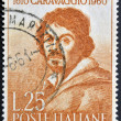 ITALY - CIRCA 1960: a stamp printed in Italy celebrates the third centenary of the death of Caravaggio showing an image of the famous italian artist, circa 1960 - Stock Photo