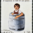 Stock Photo: ITALY - CIRC1974: stamp printed in Italy dedicated to advertising and marketing, shows child rolled on postal savings account with barrel-shaped, circ1971