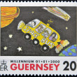Stock Photo: GUERNSEY - CIRC2000: stamp printed in Guernsey shows childlike drawing of bus in space by Fallon Ephgrave to 9 years, circ2000
