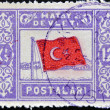 TURKEY - CIRCA 1939: A stamp printed in Turkey shows flag with star and crescent, circa 1939 - Stock Photo