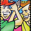Stock Photo: NEW ZEALAND- CIRC1998: stamp printed in New Zealand shows two friends greet, stay in touch, circ1998