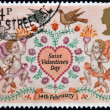 UNITED KINGDOM - CIRCA 1981: a stamp printed in the Great Britain shows Lovebirds, Angels and Heart, Valentines Day, circa 1981 — Stock Photo #9444686