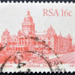 SOUTH AFRICA - CIRCA 1986: A stamp printed in South Africa shows image of the Stadsaal building in Durban, circa 1986 - Stock Photo