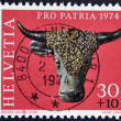 Stock Photo: SWITZERLAND - CIRC1974: stamp printed in Switzerland shows sculpture of bull's head, valere museum, sion, circ1974