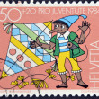 Постер, плакат: SWITZERLAND CIRCA 1984: A stamp printed in Switzerland shows Pinocchio with a kite circa 1984