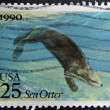 Royalty-Free Stock Photo: UNITED STATES OF AMERICA - CIRCA 1990: A stamp printed in USA shows a sea otter, circa 1990