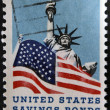 Stock Photo: UNITED STATES OF AMERIC- CIRC1966: stamp printed in USdedicated to Honoring Americservicemen and US savings bonds, shows Statue of Liberty and AmericFlag, circ1966
