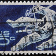UNITED STATES - CIRCA 1962: stamp printed in USA shows Space Walking Astronaut, circa 1962 - ストック写真