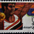 UNITED STATES OF AMERICA - CIRCA 1984: A stamp printed in the USA shows image of a shot putter and commemorates the 1984 Los Angeles Olympics, circa 1984 - ストック写真