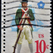 UNITED STATES - CIRCA 1970: A stamp printed in USA shows  Military uniform of the American Continental Marines. Marine with musket, fullrigged ship background, CIRCA 1970 — Foto Stock