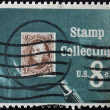 UNITED STATES OF AMERICA - CIRCA 1972: A stamp printed in USA shows Pictures magnifying glass over United States postage stamp, circa 1972 — Stock Photo #9445005
